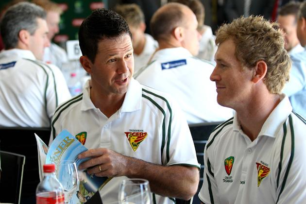 Ricky Ponting speaks with captain of Tasmanian Tigers George Bailey prior to being named Sheffield Shield player of the year during the State Cricket Awards at Blundstone Arena on March 20, 2013 in Hobart, Australia.  (Photo by Robert Prezioso/Getty Images)