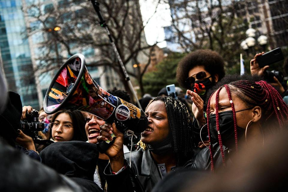 <p>A woman chants into a megaphone as the verdict is announced in Minneapolis.</p>