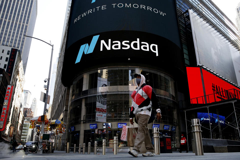 NEW YORK, NEW YORK - MARCH 10: A man walks in front Nasdaq building at Times Square on March 10, 2021, in New York. The Nasdaq Composite continued falling more than half a percent during the day. Also, the move away from Apple Inc, Amazon.com Inc , Facebook Inc, Tesla Inc and Microsoft Corp, falling during the day, helped small-cap stocks rise more than double the gains of the S&P 500. (Photo by John Smith/VIEWpress)