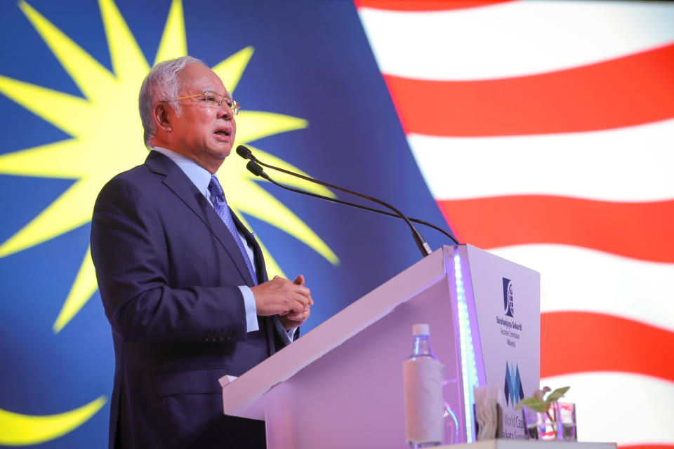 Then Malaysian Prime Minister Najib Razak speaks during the World Capital Markets Symposium in Kuala Lumpur, on Malaysia, Feb. 6, 2018. Najib was found guilty Tuesday, July 28, 2020 in his first corruption trial linked to one of the world's biggest financial scandals - the billion-dollar looting of the 1MDB state investment fund. (AP Photo/Vincent Thian)