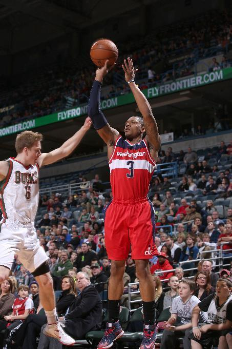 MILWAUKEE, WI - MARCH 8: Bradley Beal #3 of the Washington Wizards shoots against Nate Wolters #6 of the Milwaukee Bucks on March 8, 2014 at the BMO Harris Bradley Center in Milwaukee, Wisconsin. (Photo by Gary Dineen/NBAE via Getty Images)