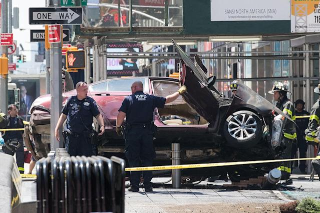 <p>A wrecked car sits in the intersection of 45th and Broadway in Times Square, May 18, 2017 in New York City. According to reports there were multiple injuries and one fatality after the car plowed into a crowd of people. (Photo: Drew Angerer/Getty Images) </p>
