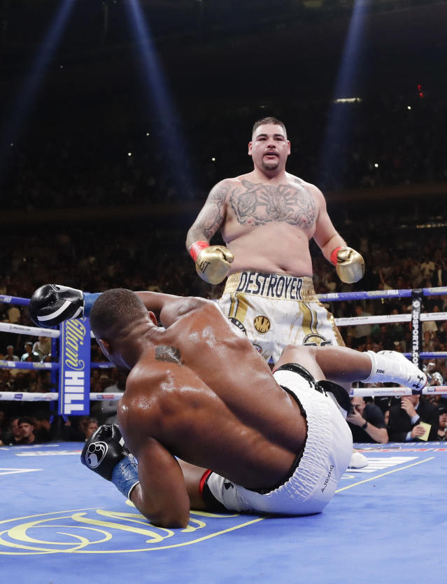 Andy Ruiz knocks down Anthony Joshua during the third round of a heavyweight championship boxing match Saturday, June 1, 2019, in New York. Ruiz won in the seventh round. (AP Photo/Frank Franklin II)