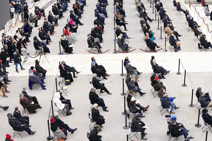 Guests attend the inauguration of Joe Biden as the 46th President of the United States on the West Front of the U.S. Capitol. (Kevin Lamarque/Reuters)