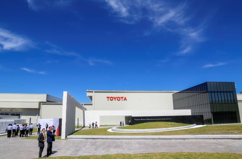 Employees walk at the Toyota Motor Corp new plant in Mexico's central state of Guanajuato