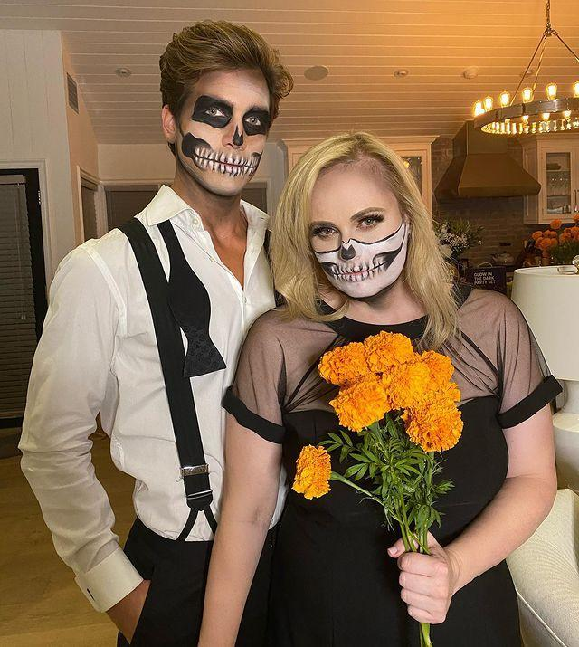 """<p>A few weeks later, the pair went all-out on their Halloween couples' costume makeup. Wilson shared a number of photos of their spooky skeleton look <a href=""""https://www.instagram.com/p/CHEf-_BrToX/"""" rel=""""nofollow noopener"""" target=""""_blank"""" data-ylk=""""slk:to Instagram,"""" class=""""link rapid-noclick-resp"""">to Instagram,</a> thanking fellow Aussie Margot Robbie """"for a frightastic Halloween bash x."""" </p>"""
