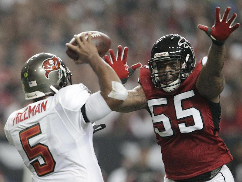 FILE - In this Jan. 1, 2012 file photo, Atlanta Falcons defensive end John Abraham (55) pressures Tampa Bay Buccaneers quarterback Josh Freeman (5) during the first half of an NFL football game in Atlanta. The Falcons have released running back Michael Turner, Abraham and cornerback Dunta Robinson The moves were announced Friday, March 1, 2013, by a team that came up just short of the Super Bowl. (AP Photo/David Goldman, File)