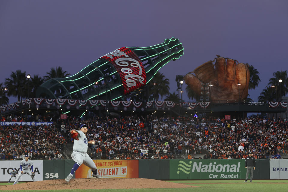 Los Angeles Dodgers' Julio Urias pitches against the San Francisco Giants during the second inning of Game 2 of a baseball National League Division Series Saturday, Oct. 9, 2021, in San Francisco. (AP Photo/John Hefti)