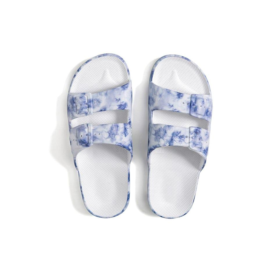 """<p><strong>Freedom Moses</strong></p><p>freedomoses.com</p><p><strong>$65.00</strong></p><p><a href=""""https://freedomoses.com/collections/slides/products/sky-tie-dye-slides?variant=39268863836221"""" rel=""""nofollow noopener"""" target=""""_blank"""" data-ylk=""""slk:SHOP NOW"""" class=""""link rapid-noclick-resp"""">SHOP NOW</a></p><p>Keep 'em stylish with these easy-to-wear, vegan tie-dye sandals. They'll pair well with all types of 'fits.</p>"""
