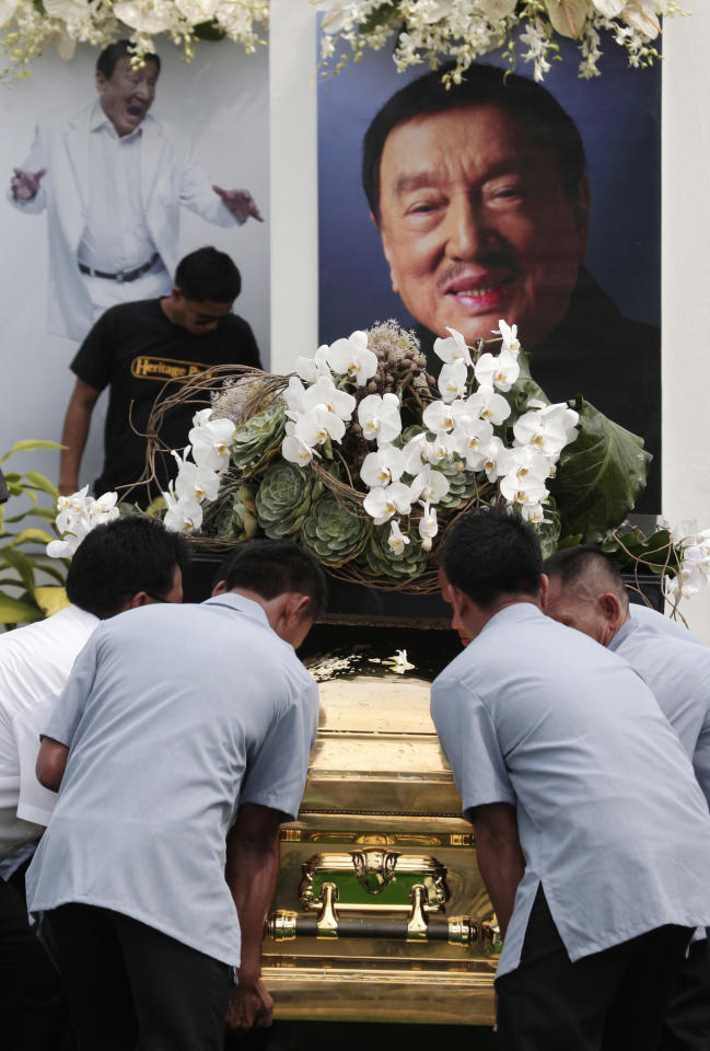 "Workers carry the casket of the country's ""King of Comedy"", Rodolfo Vera Quizon Sr., locally known as ""Dolphy"", during funeral rites at a cemetery in Taguig, south of Manila, Philippines on Sunday, July 15, 2012. Quizon starred in more than 200 films in his 66-year career. The 83-year-old died Tuesday of multiple organ failure, kidney ailments and complications from pneumonia. (AP Photo/Aaron Favila)"