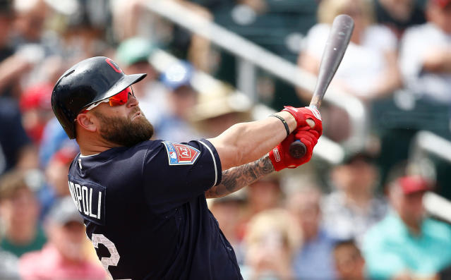 FILE - In this March 22, 2018, file photo, Cleveland Indians' Mike Napoli follows through on a swing during the fourth inning of a spring training baseball game against the San Diego Padres, in Goodyear, Ariz. Former Indians slugger Mike Napoli will undergo season-ending knee surgery after getting hurt in the minors. Napoli sustained a torn right anterior cruciate ligament earlier this week while playing for Triple-A Columbus. The 36-year-old will have the operation once the swelling in his knee goes down, and the Indians said that could take as much as two weeks. The injury is career threatening for the 36-year-old, who had his best season in 2016 when he helped lead the Indians to the World Series. (AP Photo/Ross D. Franklin, File)