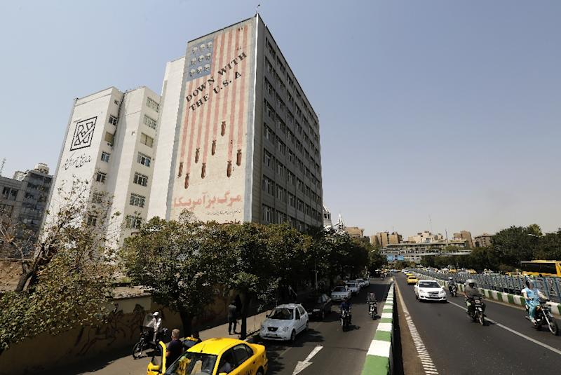A mural in Tehran shows a US flag with skulls instead of stars (AFP Photo/ATTA KENARE)