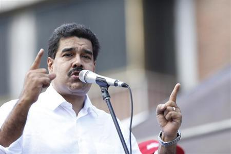 Venezuelan President Nicolas Maduro talks to supporters during a meeting outside Miraflores Palace in Caracas