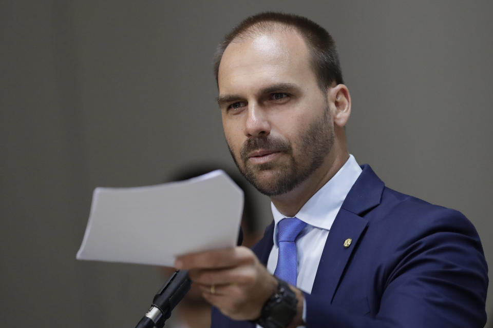 Brazilian lawmaker Eduardo Bolsonaro speaks during the opening of the International Seminar Challenges to National Defense and the role of the Armed Forces, in the Foreign Relations Committee of the Chamber of Deputies, in Brasilia, Brazil, Wednesday, Aug. 14, 2019. Federal prosecutors in Brazil filed a motion Monday that could block President Jair Bolsonaro's son, Eduardo, from becoming ambassador to Washington. (AP Photo/Eraldo Peres)