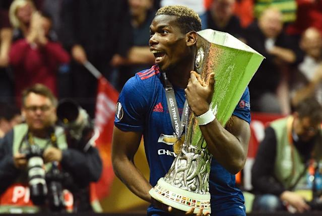 Manchester United's Paul Pogba celebrates with the UEFA Europa League trophy after winning their match against Ajax Amsterdam on May 24, 2017 at the Friends Arena in Solna outside Stockholm (AFP Photo/Jonathan NACKSTRAND)