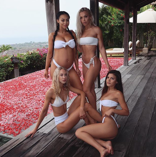 <p>The Gold Coast mum shared a snap of her relaxing poolside alongside her sisters in matching white bikinis. Photo: Instagram/tammyhembrow </p>