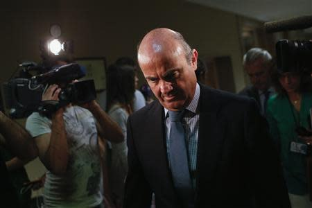 Spain's Economy Minister de Guindos arrives at parliamentary hearing at the Spanish parliament in Madrid