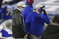 Baltimore Ravens head coach John Harbaugh, left, talks to Buffalo Bills head coach Sean McDermott before an NFL divisional round football game Saturday, Jan. 16, 2021, in Orchard Park, N.Y. (AP Photo/Adrian Kraus)