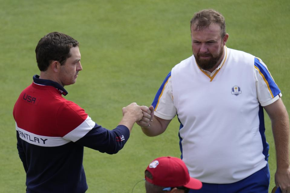 Team USA's Patrick Cantlay greets Team Europe's Shane Lowry on the first tee during a singles match the Ryder Cup at the Whistling Straits Golf Course Sunday, Sept. 26, 2021, in Sheboygan, Wis. (AP Photo/Ashley Landis)
