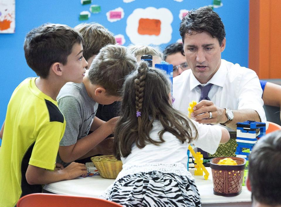 Justin Trudeau plays with children at a daycare centre.