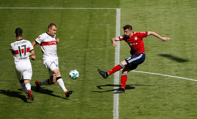 Soccer Football - Bundesliga - Bayern Munich v VfB Stuttgart - Allianz Arena, Munich, Germany - May 12, 2018 Bayern Munich's Robert Lewandowski shoots at goal REUTERS/Michaela Rehle DFL RULES TO LIMIT THE ONLINE USAGE DURING MATCH TIME TO 15 PICTURES PER GAME. IMAGE SEQUENCES TO SIMULATE VIDEO IS NOT ALLOWED AT ANY TIME. FOR FURTHER QUERIES PLEASE CONTACT DFL DIRECTLY AT + 49 69 650050