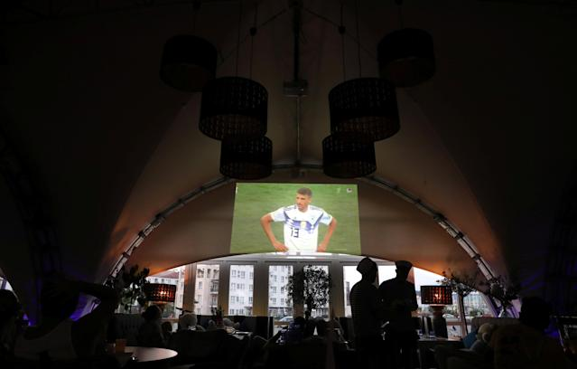 Soccer Football - FIFA World Cup - Group F - Germany v Mexico - Sochi, Russia - June 17, 2018 - Germany's Thomas Muller is seen at the end of their match against Mexico on a large TV screen at a restaurant. REUTERS/Marcos Brindicci