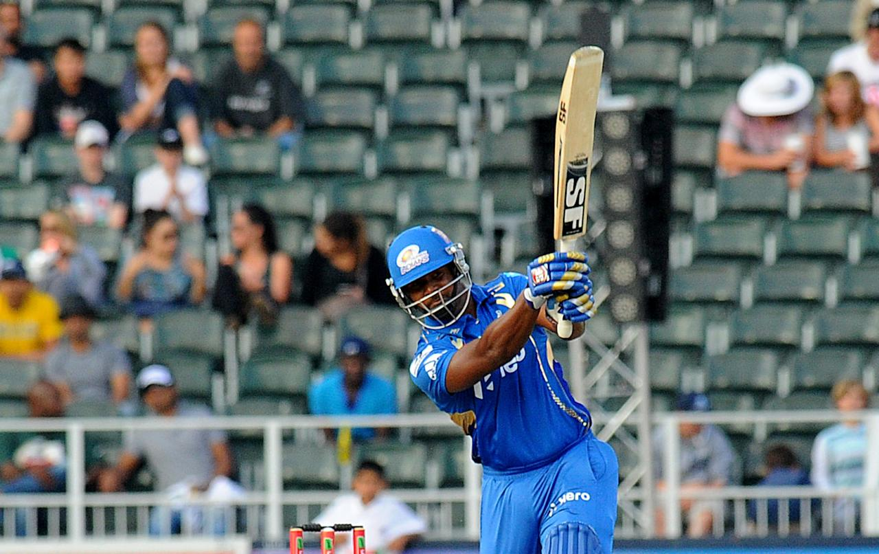 Mumbai Indians batsman Dwayne Smith plays a shot during a Group B match of the Champions League T20 (CLT20) between the Highveld Lions and the Mumbai Indians at the Wanderers Stadium in Johannesburg on October 14, 2012. AFP PHOTO / ALEXANDER JOE