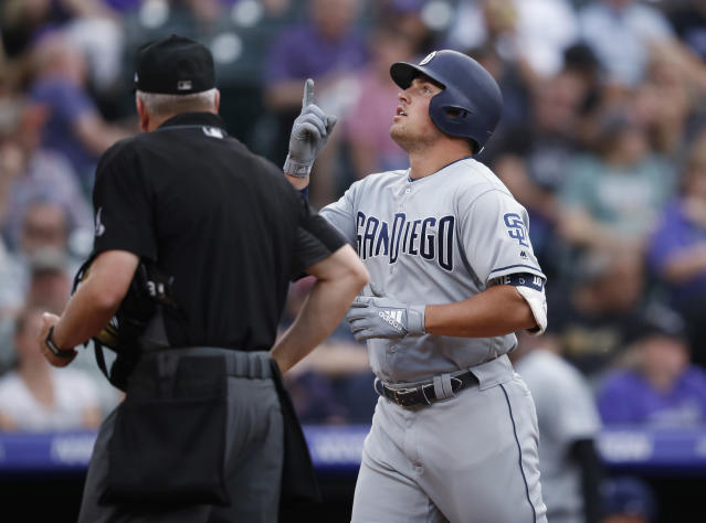 San Diego Padres' Hunter Renfroe gestures as he crosses home plate after hitting a solo home run off Colorado Rockies starting pitcher Jeff Hoffman during the second inning of a baseball game Friday, June 14, 2019, in Denver. (AP Photo/David Zalubowski)