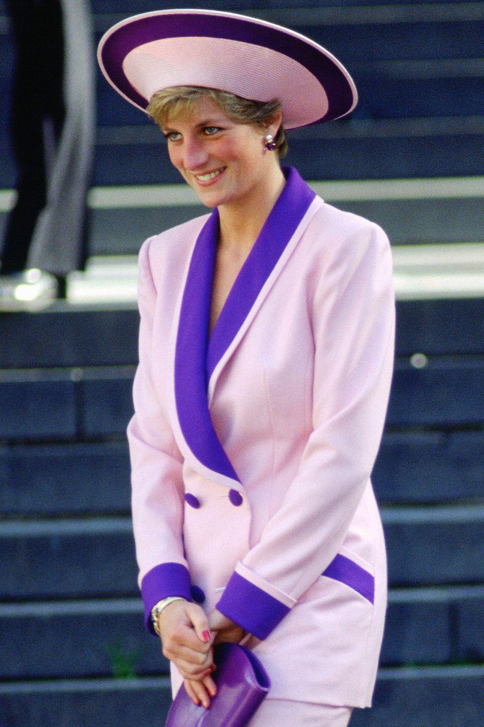 <p>In a pink-and-purple upside down-brim hat. </p>
