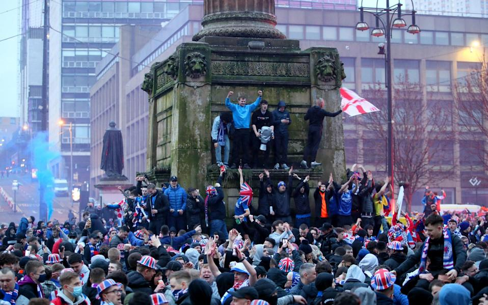 Rangers fans celebrate in George Square after Rangers win the Scottish Premiership title - PA