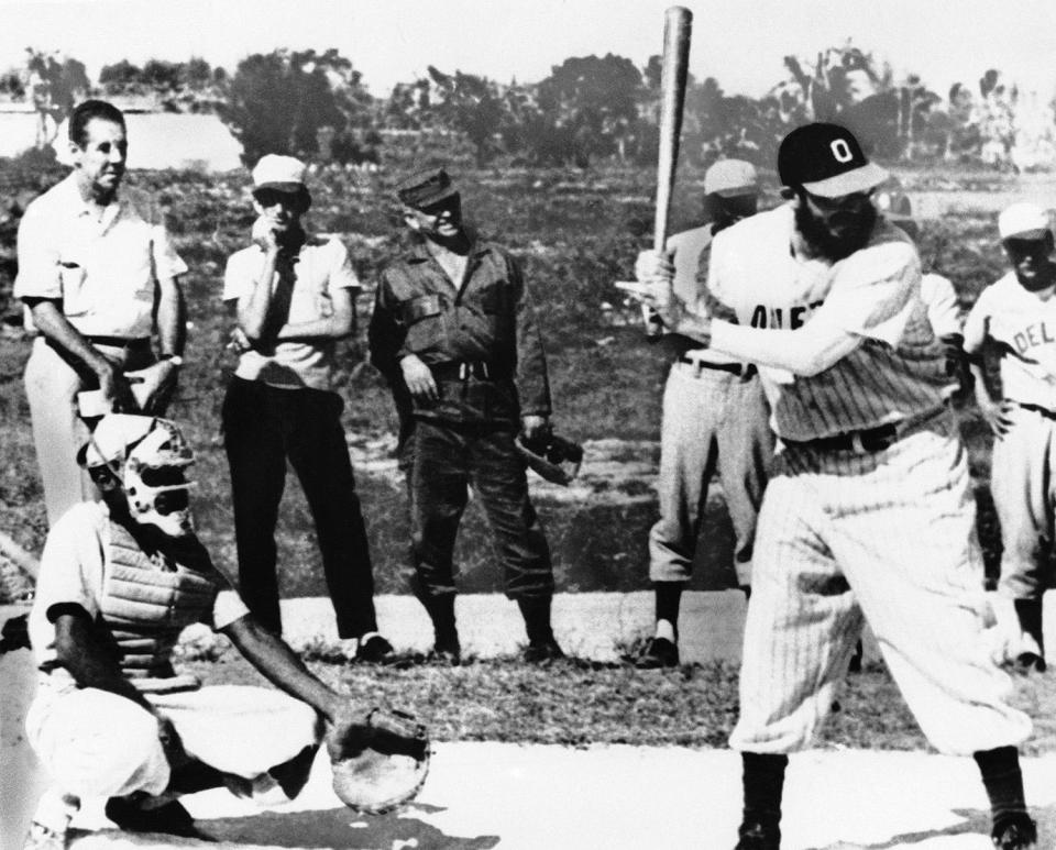 <p>Fidel Castro waits for a good one as he bats for Camaguey Province against Pinar Del Rio Province at Cuba's Varadero Beach, July 5, 1964. The Cuban premier hit two singles and drove in four runs in Camaguey's 14-4 win. He pitched a perfect game for seven innings and went the full nine innings on the mound. (AP Photo/Harold Valentine) </p>
