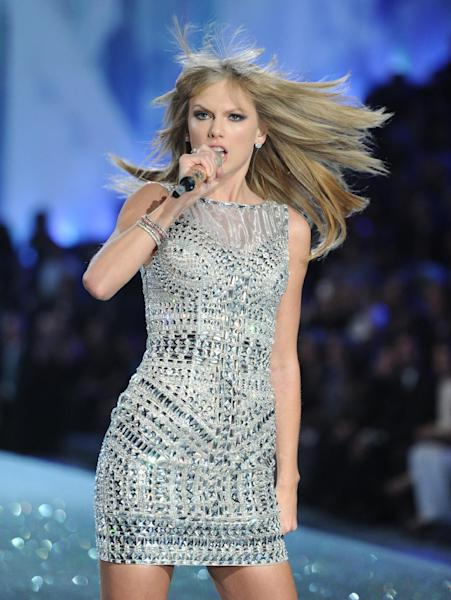 FILE - In this Nov. 13, 2013 file photo, singer Taylor Swift performs on the runway during the 2013 Victoria's Secret Fashion Show at the 69th Regiment Armory in New York. Not a lot of fans knew who Macklemore & Ryan Lewis and Lorde were when last we gathered a year ago to celebrate music with the Grammy Awards nominations. Yet thanks to a series of inescapable and smart hits, these upstarts could very well muscle Justin Timberlake, Swift and other Grammy favorites out of the way when nominees are announced Friday night Dec. 6, 2013, in a television special broadcast live on CBS. (Photo by Evan Agostini/Invision/AP, File)