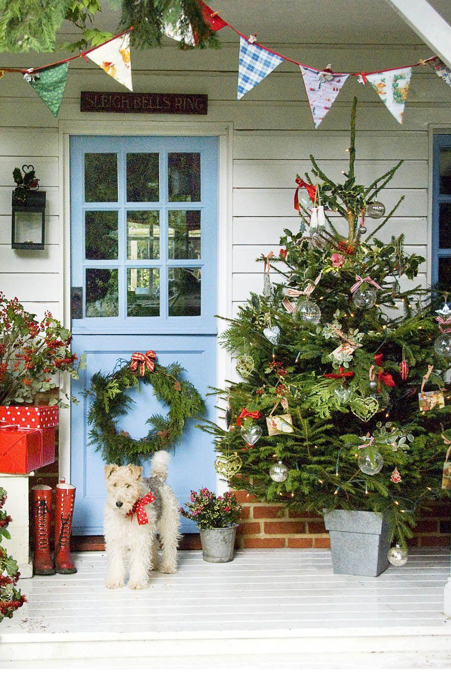 <p>Who says Christmas trees are just for inside? Spread the holiday cheer by decorating a tree to live on your front porch. </p>