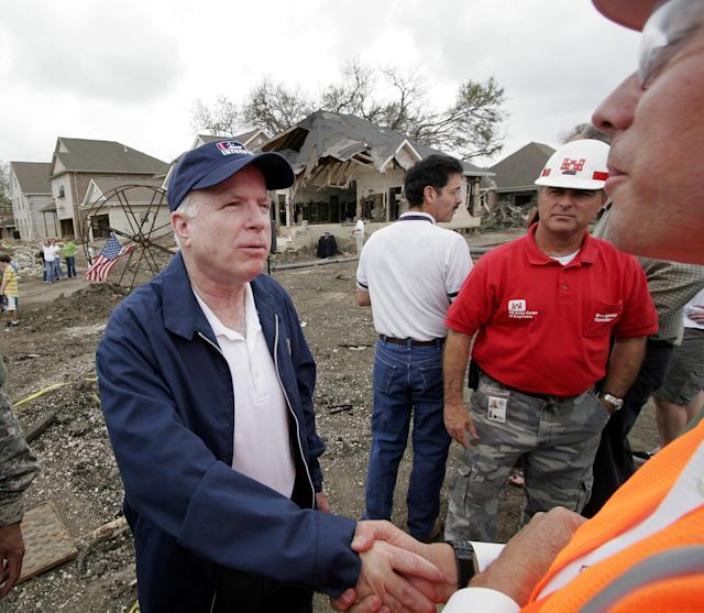 <p>Sen. John McCain shakes hands with Army Corps of Engineers structural engineer Fred Young far right, near the break of the 17th Street canal levee in the Lakeview area of New Orleans on Friday, March 10, 2006. (Photo: Alex Brandon/AP) </p>