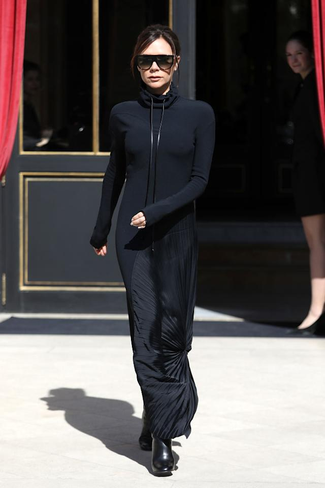 <p>On the very same day, the former Spice Girl changed into an all-black look accessorised with her trademark sunnies. <em>[Photo: Getty]</em> </p>