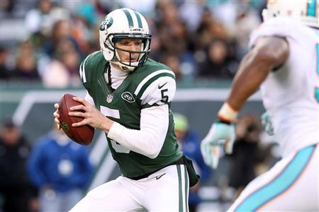 Dec 1, 2013; East Rutherford, NJ, USA; New York Jets quarterback Matt Simms (5) drops back to pass against the Miami Dolphins during the third quarter of a game at MetLife Stadium. The Dolphins defeated the Jets 23-3. Brad Penner-USA TODAY Sports