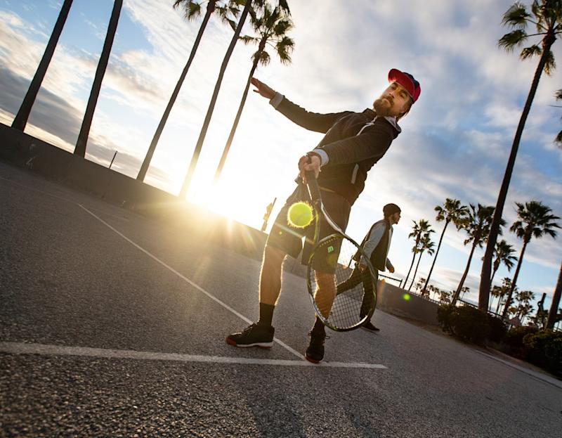 Tanner Wells, 41, practices tennis on the courts at Venice Beach on Thursday.