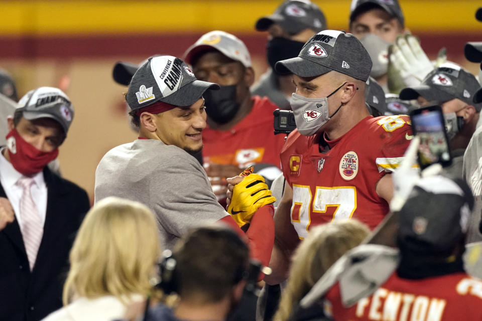 Kansas City Chiefs quarterback Patrick Mahomes, left, celebrates with teammate Travis Kelce after the AFC championship NFL football game against the Buffalo Bills, Sunday, Jan. 24, 2021, in Kansas City, Mo. The Chiefs won 38-24. (AP Photo/Charlie Riedel)