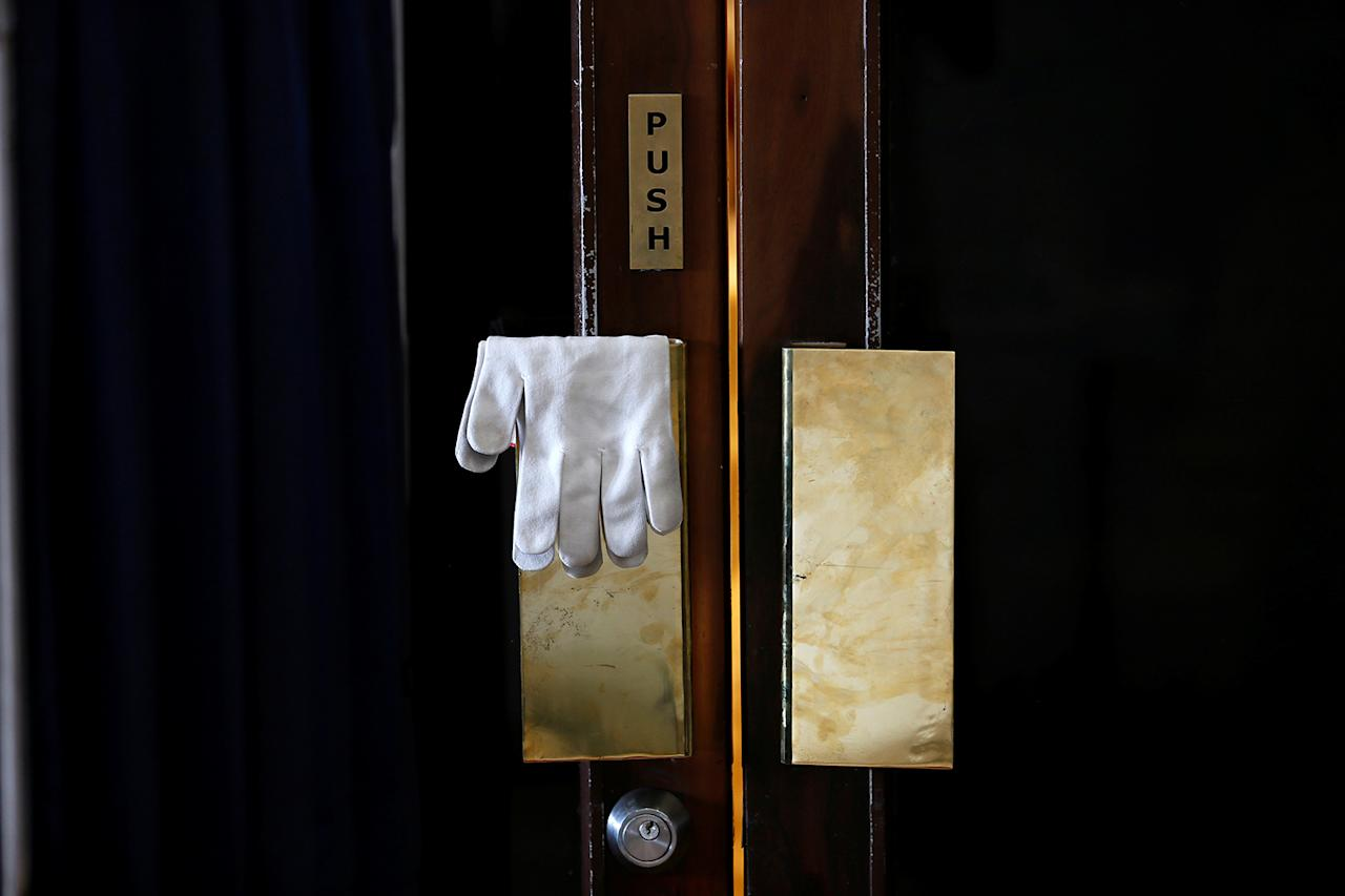<p>A pair of gloves belonging to a security officer hangs on a door lock near a checkpoint before Indiaís Prime Minister Narendra Modi leaves the United Nations Vesak Day Conference in Colombo, Sri Lanka on May 12, 2017. (Photo: Dinuka Liyanawatte/Reuters) </p>
