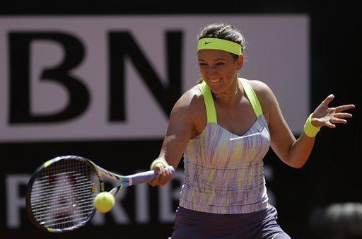 Belarus' Victoria Azarenka returns the ball to Serena Williams, of the United States, during their final match at the Italian Open tennis tournament in Rome, Sunday, May 19, 2013. (AP Photo/Andrew Medichini)