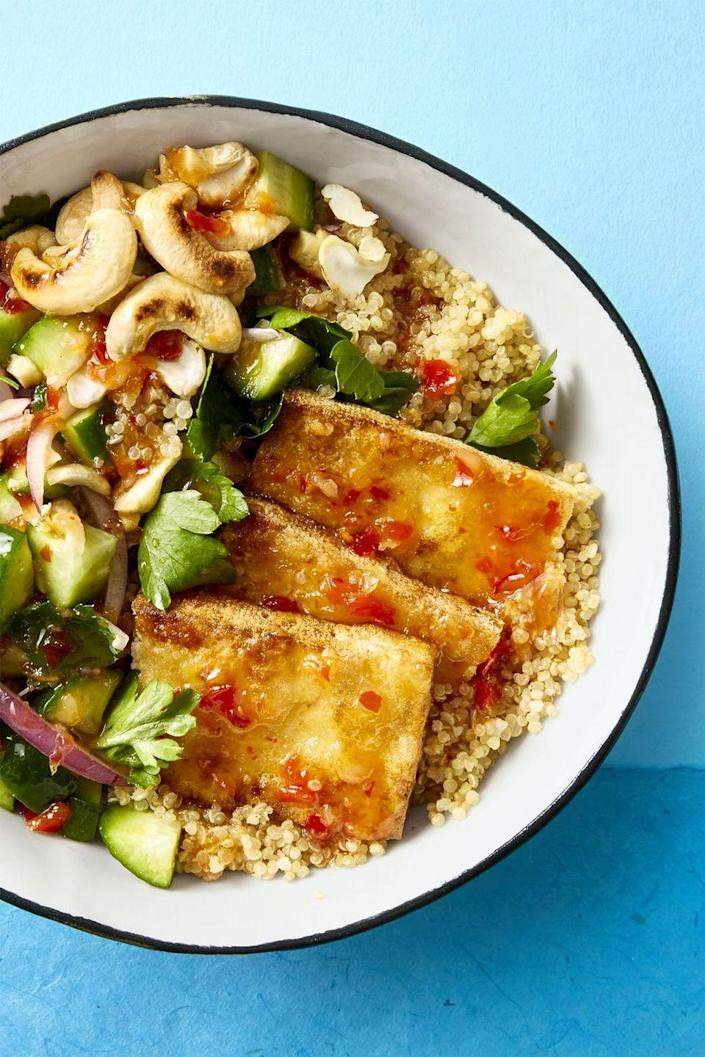 """<p>Fried tofu adds a delicious crunch to this cucumber and cashew-filled vegan quinoa bowl. You can swap in rice!</p><p><em><a href=""""https://www.goodhousekeeping.com/food-recipes/easy/a45226/crispy-tofu-bowl-recipe/"""" rel=""""nofollow noopener"""" target=""""_blank"""" data-ylk=""""slk:Get the recipe for Crispy Tofu Bowl »"""" class=""""link rapid-noclick-resp"""">Get the recipe for Crispy Tofu Bowl »</a></em></p><p><strong>RELATED: </strong><a href=""""https://www.goodhousekeeping.com/food-recipes/healthy/g2319/vegetarian-tofu-recipes/"""" rel=""""nofollow noopener"""" target=""""_blank"""" data-ylk=""""slk:28 Easy Tofu Recipes Both Vegetarians and Meat Lovers Can Get Behind"""" class=""""link rapid-noclick-resp"""">28 Easy Tofu Recipes Both Vegetarians and Meat Lovers Can Get Behind</a></p>"""