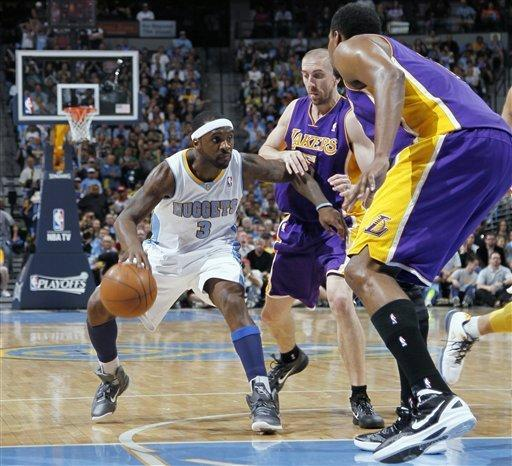 Denver Nuggets guard Ty Lawson, left, looks to work theball inside as Los Angeles Lakers guard Steve Blake, center, and center Andrew Bynum cover in the third quarter of the Nuggets' 113-96 victory in Game 6 of the teams' first-round NBA basketball series in Denver on Thursday, May 10, 2012. (AP Photo/David Zalubowski)