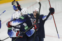US players celebrate after scoring their side's fifth goal during the Ice Hockey World Championship quarterfinal match between the United States and Slovakia at the Arena in Riga, Latvia, Thursday, June 3, 2021.(AP Photo/Sergei Grits)