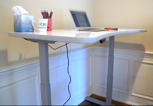 PowerUp desk with a laptop on it