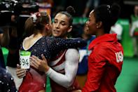 <p>Alexandra Raisman (C) of the United States is embraced by her team mate Madison Kocian (L) during the Artistic Gymnastics Women's Team Final on Day 4 of the Rio 2016 Olympic Games at the Rio Olympic Arena on August 9, 2016 in Rio de Janeiro, Brazil. (Photo by Lars Baron/Getty Images) </p>