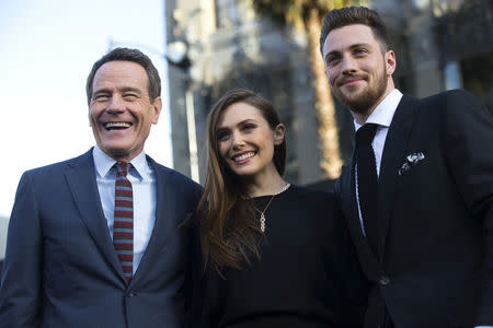 "Cast members Cranston, Olsen and Taylor-Johnson pose at the premiere of ""Godzilla"" at the Dolby theatre in Hollywood"