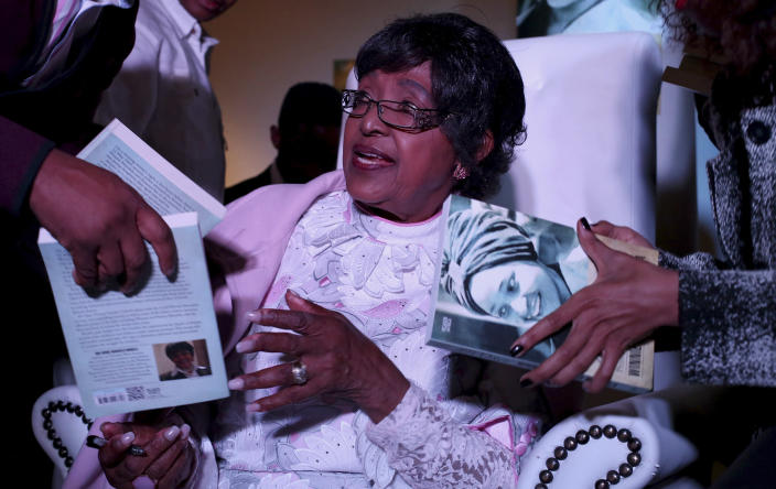 "<p>Winnie Madikizela-Mandela, ex-wife of former South African President Nelson Mandela, is given copies to sign during a celebratory event for the release of her book, ""491 Days,"" on Aug. 8, 2013. (Photo: Siphiwe Sibeko/Reuters) </p>"
