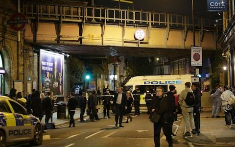 Police at the scene outside Parsons Green Tube station in London where three men have been stabbed - Credit: Yui Mok/PA