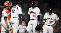 Houston Astros starting pitcher Lance McCullers Jr. (43) is removed from the baseball game by manager Dusty Baker Jr. (12) during the fifth inning against the Cleveland Indians, Wednesday, July 21, 2021, in Houston. (AP Photo/Eric Christian Smith)