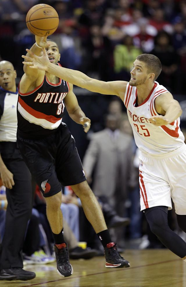 Portland Trail Blazers' Nicolas Batum (88) and Houston Rockets' Chandler Parsons (25) reach for a loose ball during the first quarter of an NBA basketball game on Sunday, March 9, 2014, in Houston. (AP Photo/David J. Phillip)